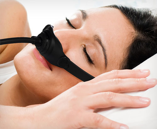 Woman sleeping with the Somnera System