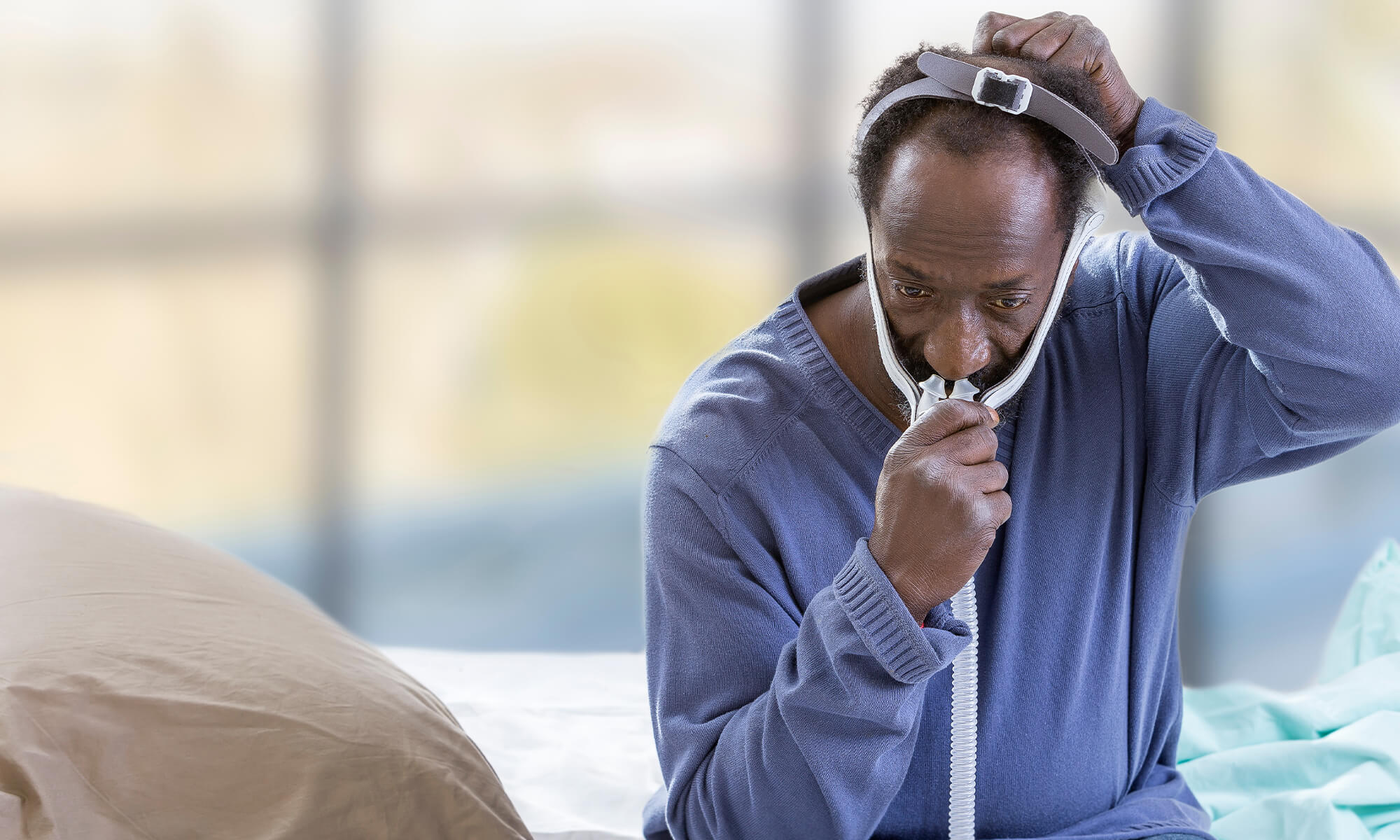 Man using positive airway pressure therapy