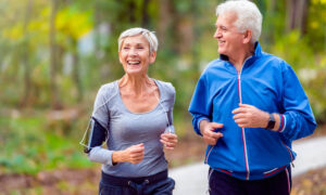 Older couple jogging outdoors